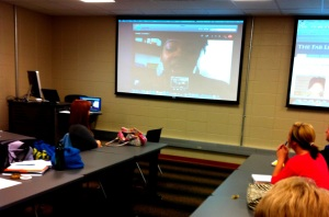 Amber Adams addressing students in CO 110 Intro to Mass Comm via Skype.